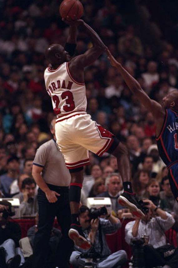 5 May 1996:  Guard Michael Jordan of the Chicago Bulls takes a shot against Derek Harper of the New York Knicks during a game played at the United Center in Chicago, Illinois.  The Bulls won the game, 91-84. Mandatory Credit: Doug Pensinger/Allsport